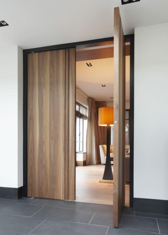 Fritsjurgens Floor To Ceiling Pivot Doors With Concealed